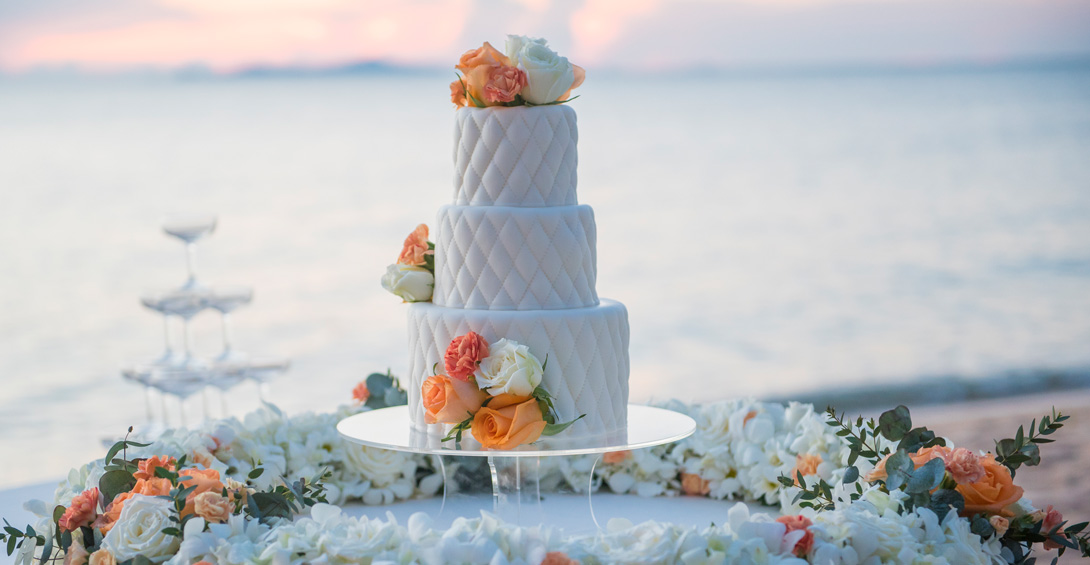 Wedding cake with flowers to match the Caribbean sunset