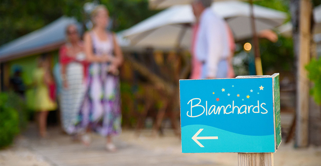 Directional signage on beach path leading guests at private event to Blanchards restaurant