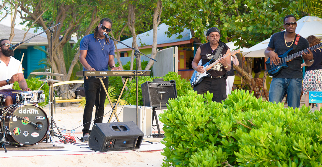 Wedding band plays on beach in front of Blanchards