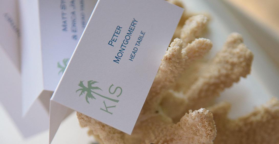Wedding table arrangements set on coral