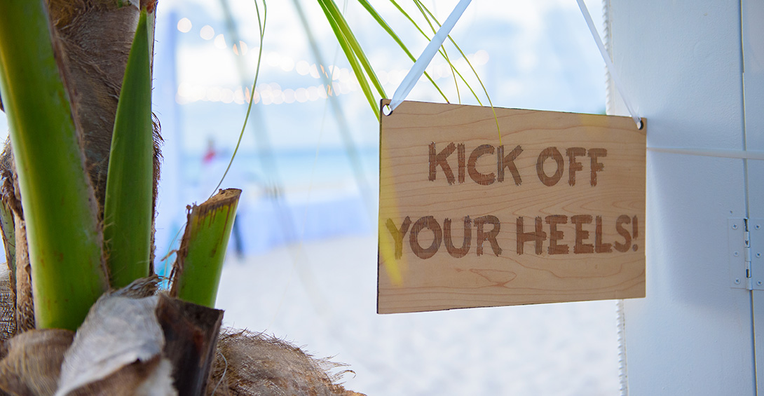 Sign says :kick off your heels