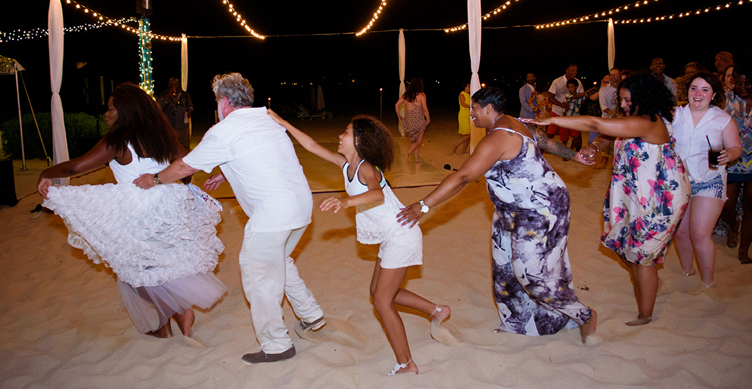 Wedding guests dance conga line on Meads Bay beach at Blanchards