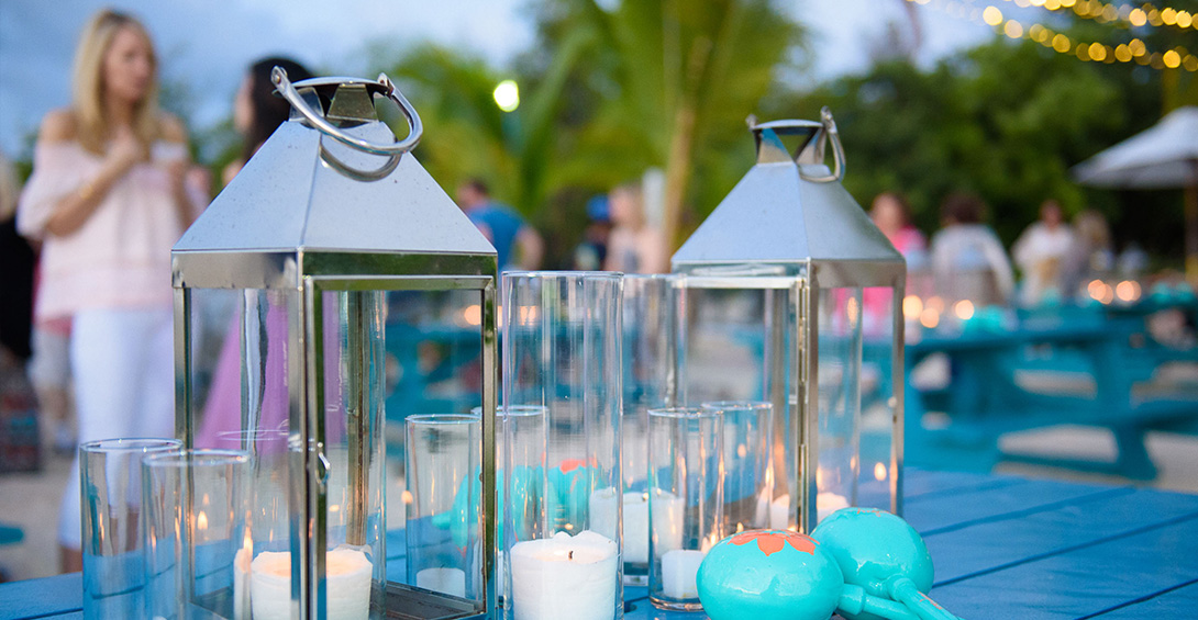 Blanchards beach shack table decorations on blue picnic tables