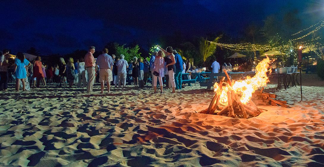 Beach bonfire glows in front of a private party outside Blanchards Beach Shack in Anguilla