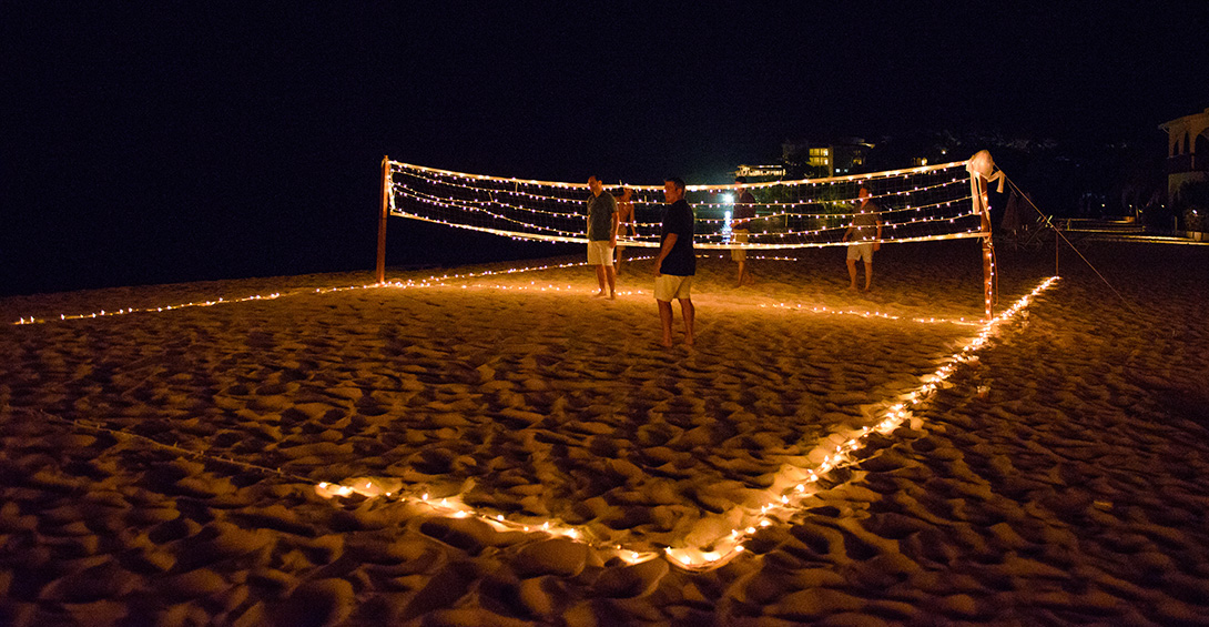Beach games lit with candles and twinkly lights at night