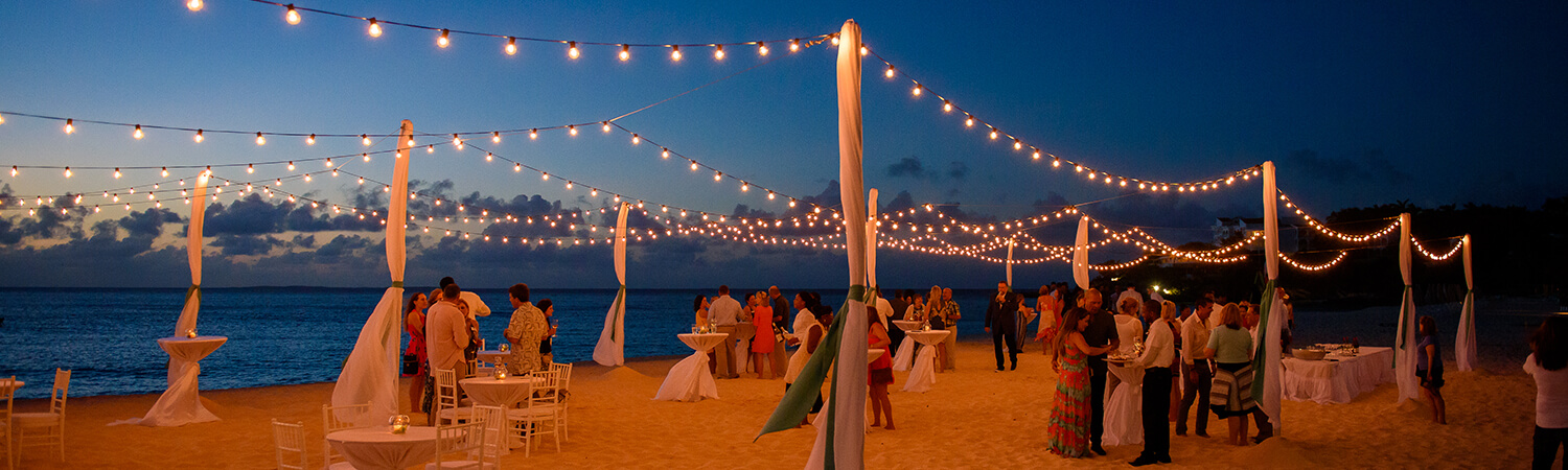 Meads Bay beach Anguilla with private event at Blanchards and twinkly lights across the night sky
