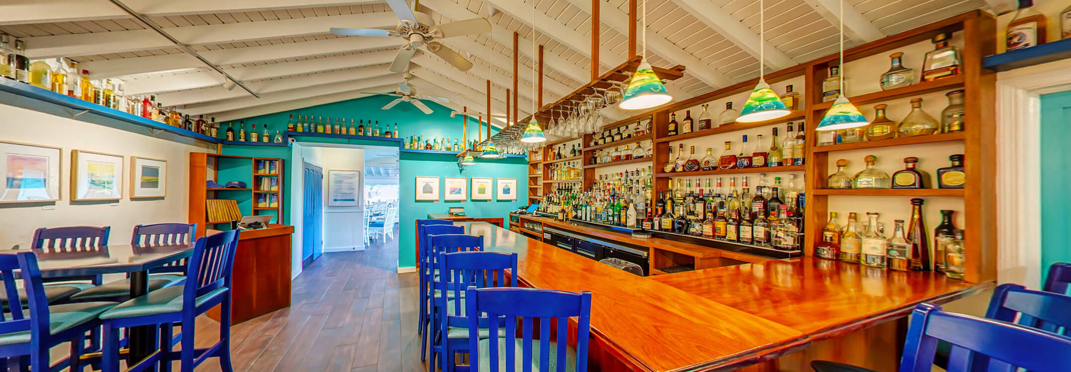 Blanchards bar with bright Caribbean colors stocked with premium liquors