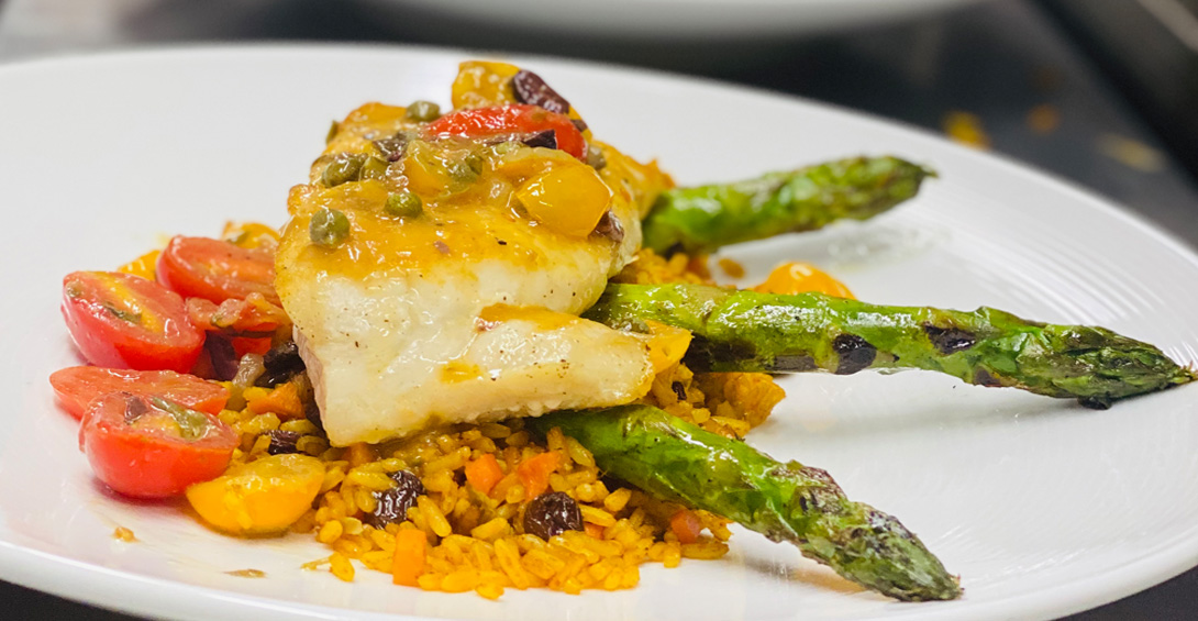 Grouper with curried rice and asparagus plated at Blanchards Restaurant a